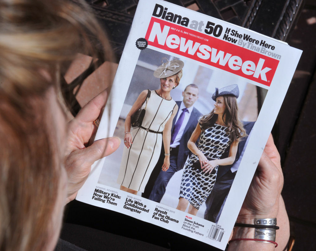 A Newsweek magazine is viewed by a reader on June 29, 2011 in Washington, DC from the July 4 and 11, 2011 double issue of