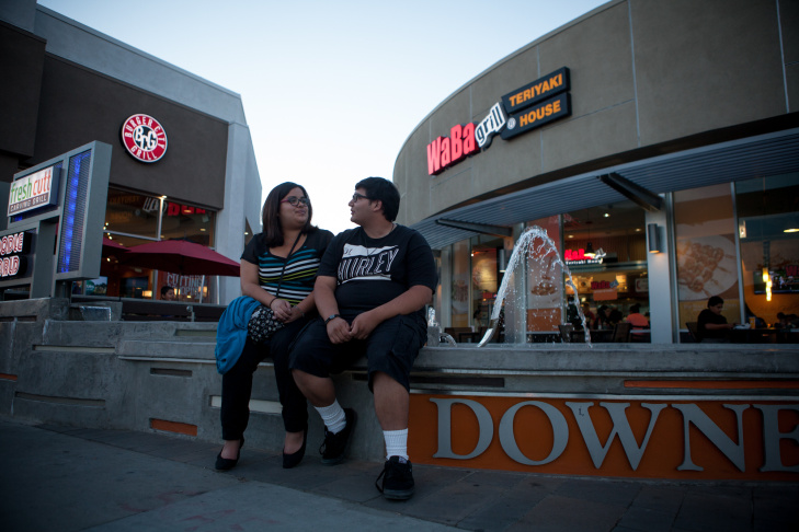 Jessica Haro and Eric Ibarra sit at a fountain on the corner of Firestone Blvd and Downey Ave on November 9th, 2013.