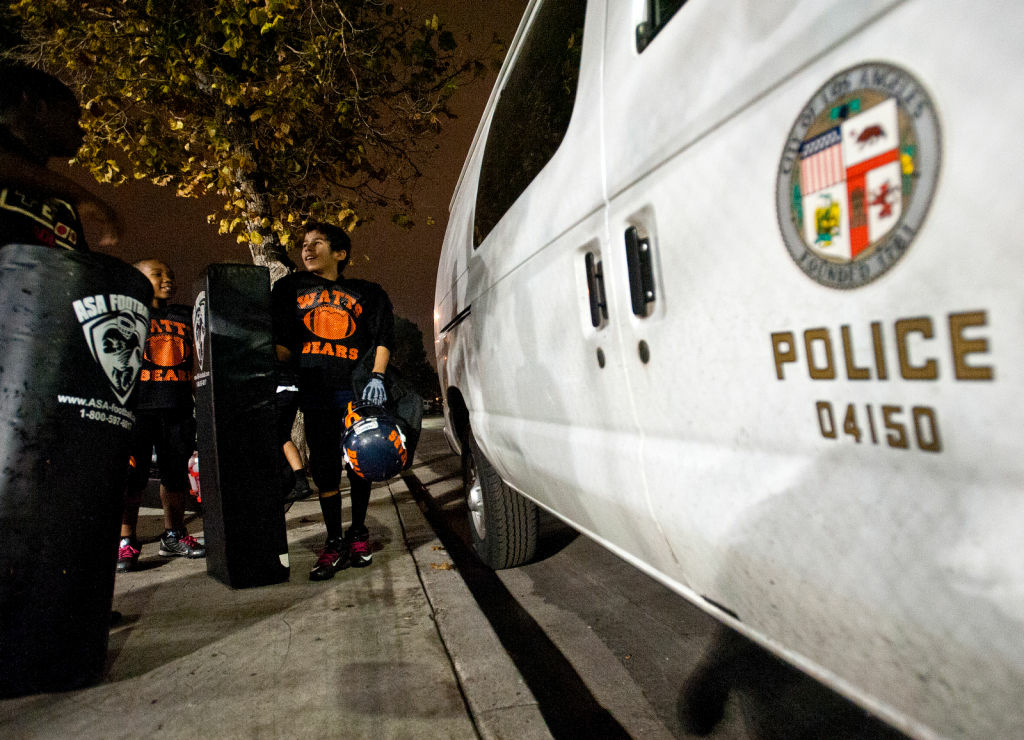 Players load equipment into Police vans after practice on Thursday evening on 109th Street.