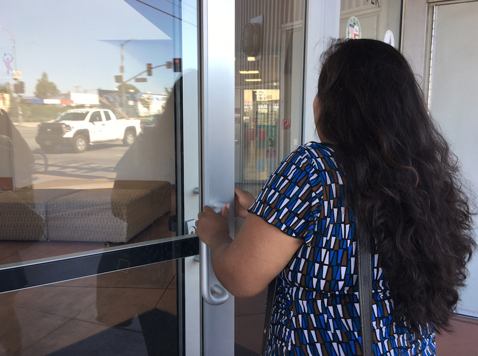 Carolina, who arrived 12 years ago on a tourist visa and overstayed, enters a Southern California community center. She is one of the thousands of visitors who come to the U.S. each year and stay after their visas expire.