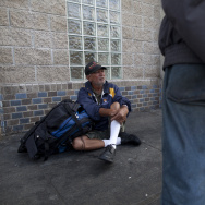 Social services workers try to convince a homeless man to get off Skid Row and seek help around the corner at the Volunteers of America building. But it often takes many attempts to finally get someone to accept the services they need, Los Angeles Homeless Service's Authority employee Gabriel Jimenez said.