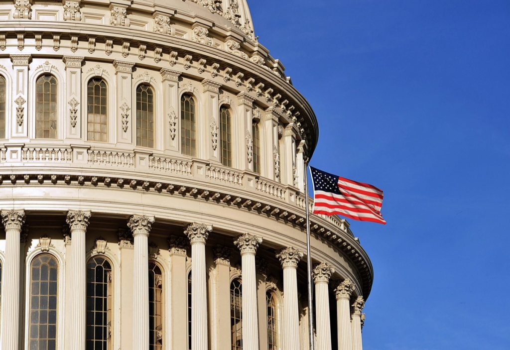 File: This Oct. 26, 2011 photo shows the U.S. flag flying at the Capitol building in Washington, DC.