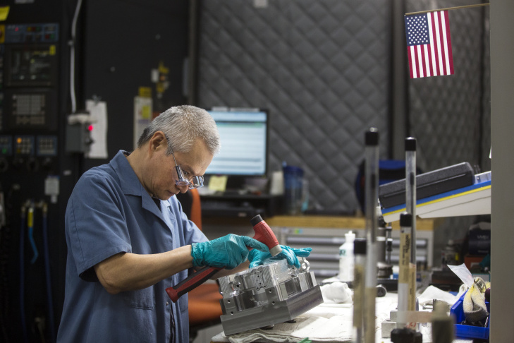 Machinist Frank Ho works inside Aerojet Rocketdyne's 100,000 square-foot manufacturing facility in Canoga Park on Friday afternoon, March 25, 2016. The company makes products for the aerospace and defense markets.