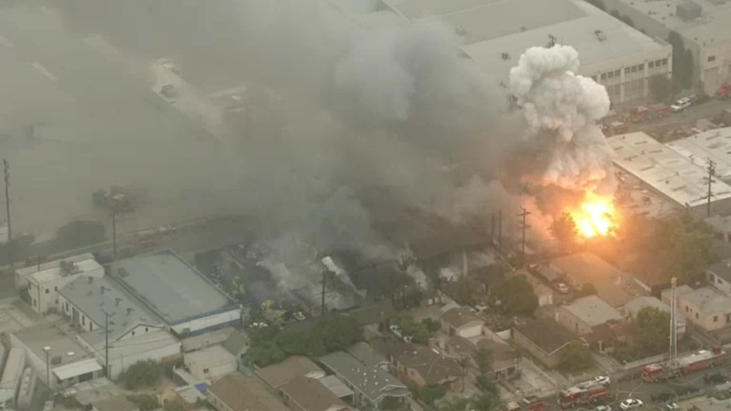 Aerial footage from KPCC's media partner NBC4 showed fire and smoke rising from what fire officials said was a recycling plant fire early Tuesday, June 14, 2016.