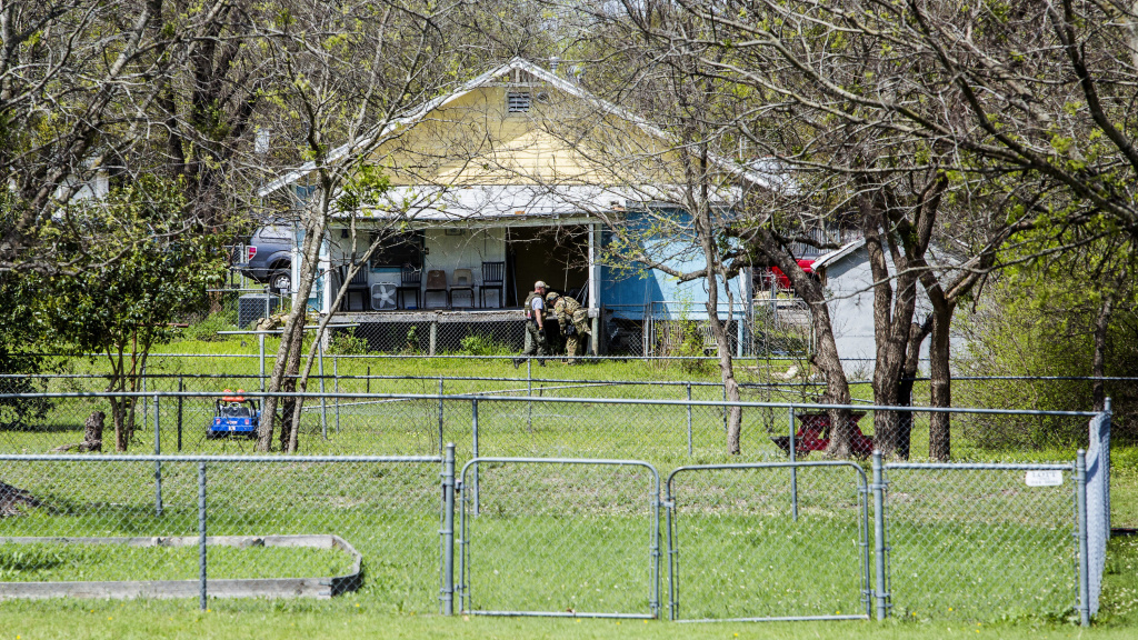 Law enforcement search the home of suspected Austin bomber Mark Anthony Conditt Wednesday in Pflugerville, Texas.