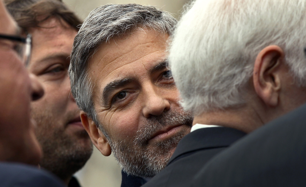 Actor George Clooney waits to be arrested during a demonstration outside the Embassy of Sudan March 16, 2012 in Washington, D.C.