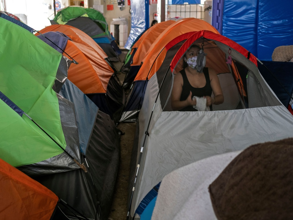 Mexican asylum seeker Eily Sanchez cleans her tent at a migrant shelter in Tijuana, Mexico, last month.