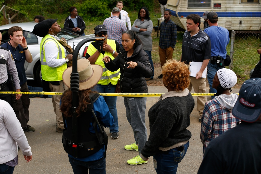 Gina Prince-Bythewood (center), with cast and crew on the set of
