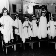 Ran Yaniv, aged 3, fourth child from left, with friends, lighting Hannukah candles at the Jewish kindergarten in London.