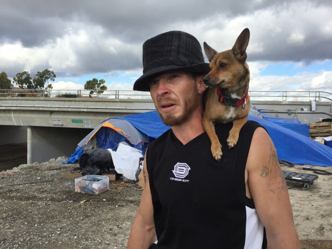 Jon Chandler, 33, rode out this week's El Nino storms inside his tent pitched on higher ground along the Santa Ana River Trail in Orange. Flood waters released from dam gates could force him to move to. January 7, 2015.