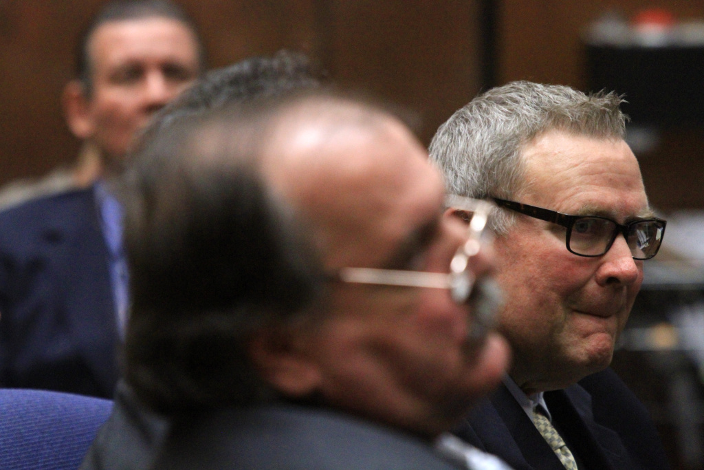 File photo: Former Bell council member George Cole, who is charged with misappropriation of public funds, listens to closing arguments presented by Deputy Dist. Atty. Edward Miller on February 13, 2013 in Los Angeles. Cole was ultimately convicted. On Wednesday, he was sentenced to 180 days of home confinement and ordered to repay more than $77,000 to the city.