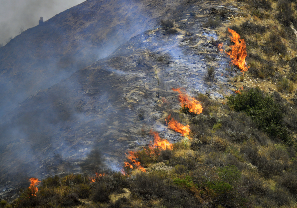 The Brand Fire burns down a hillside near Glendale Sunday afternoon. The Brand Fire burns near Glendale and Burbank on Sunday, June 22nd, 2014.