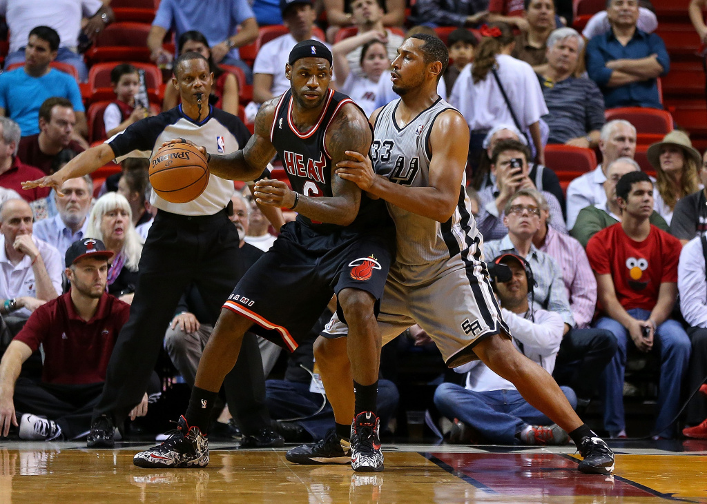 LeBron James #6 of the Miami Heat posts up Boris Diaw #33 of the San Antonio Spurs during a game  at American Airlines Arena on January 26, 2014 in Miami, Florida.