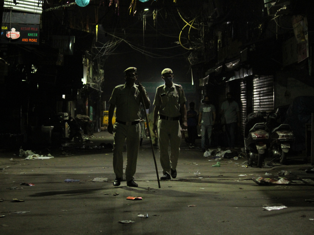 Police officers stand guard during a night curfew designed to limit the spread of the coronavirus in New Delhi April 6, 2021. The national capital imposed a 10 pm to 5 am curfew until April 30.