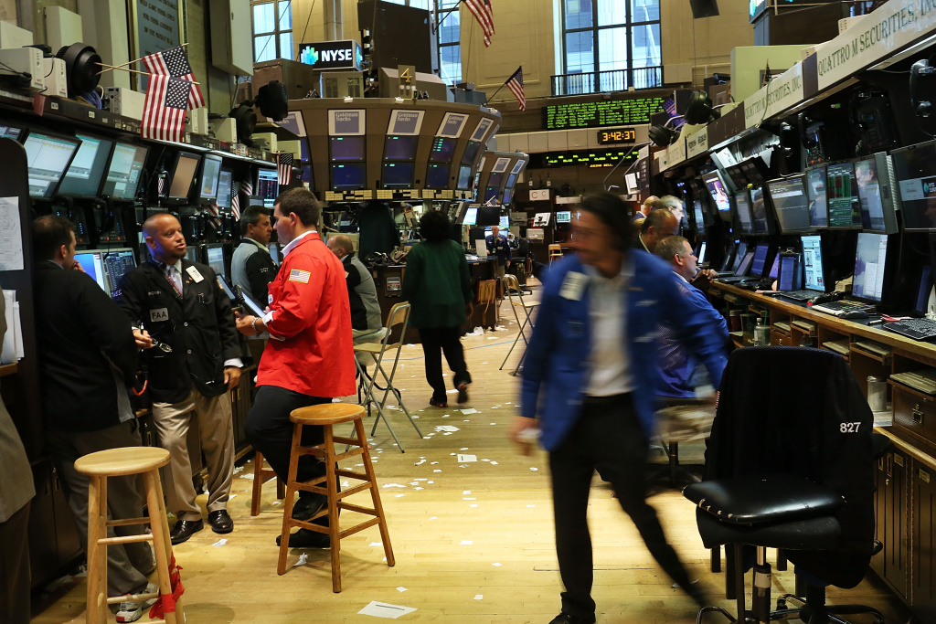 Traders work on the floor of the New York Stock Exchange on July 6, 2012 in New York City.