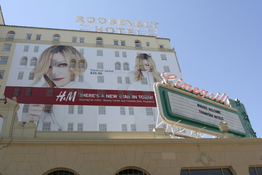 A giant vinyl billboard hangs outside the Hollywood Roosevelt Hotel.