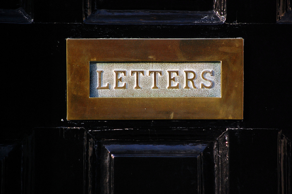 letters mail slot door
