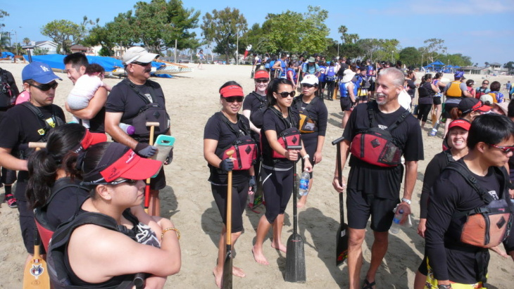 The Los Angeles Racing Dragons convene before they practice rowing their dragon boat in Long Beach, Calif.