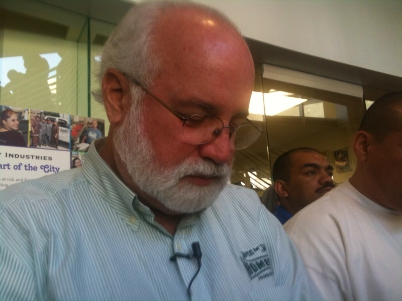 Father Greg Boyle in prayer after announcing layoffs at Homeboy Industries, May 14, 2010.