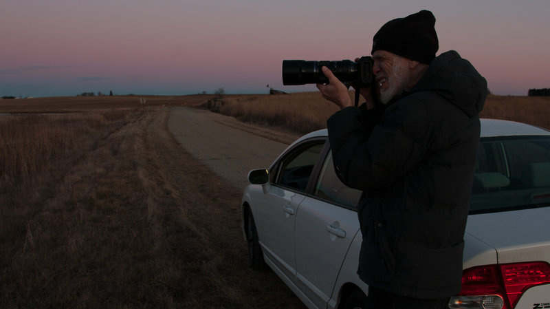 Neal Deunk photographs geese at a wildlife refuge north of Madison, Wis.