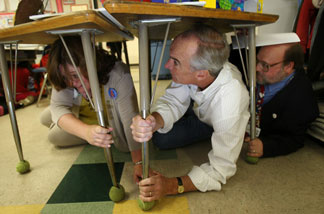 File photo: Then-US Secretary of the Interior Dirk Kempthorne (C) and United States Geological Service (USGS) Seismologist Lucy Jones (L) participate with students of Stevenson Elementary School as they drop, cover and hold on during the region-wide simulation of an expected catastrophic 7.8 magnitude earthquake on the San Andreas Fault during the Great Southern California ShakeOut earthquake drill, the largest earthquake preparedness event in US history, on Nov. 13, 2008 in Burbank.