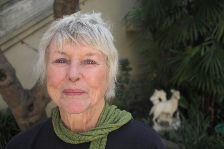 Barbara T. Smith in the Pacific Asia Museum's courtyard, where the Pasadena Museum of Art once stood.