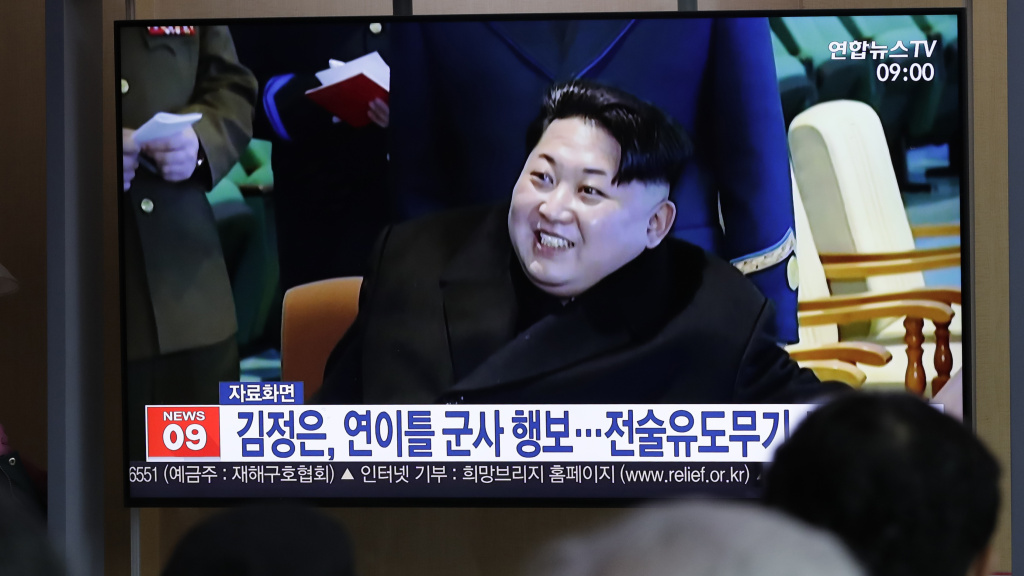 A TV report in South Korea uses file footage of North Korean leader Kim Jong Un, who supervised the test-firing of a