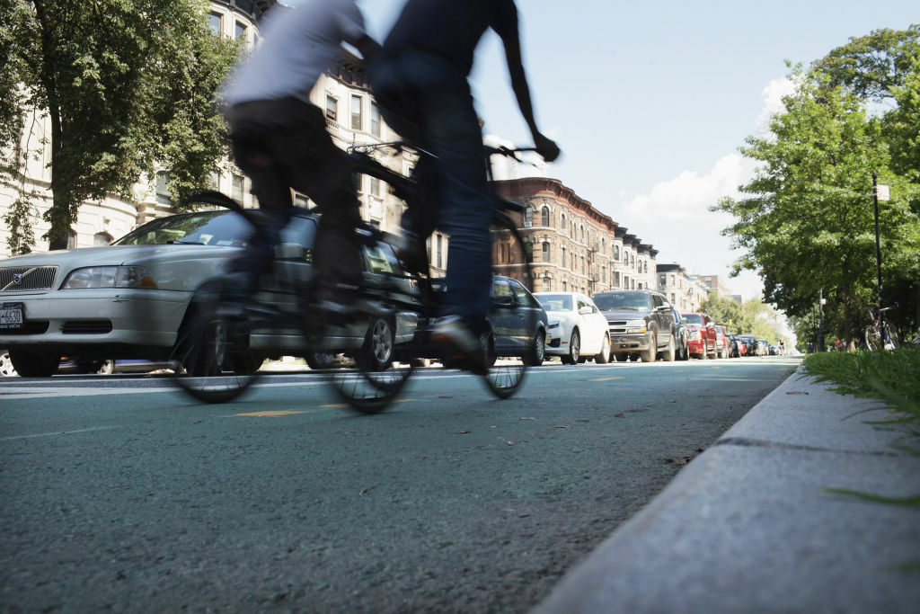 People ride along a controversial bike lane on Prospect Park West on August 17, 2011 in the Brooklyn borough of New York City.