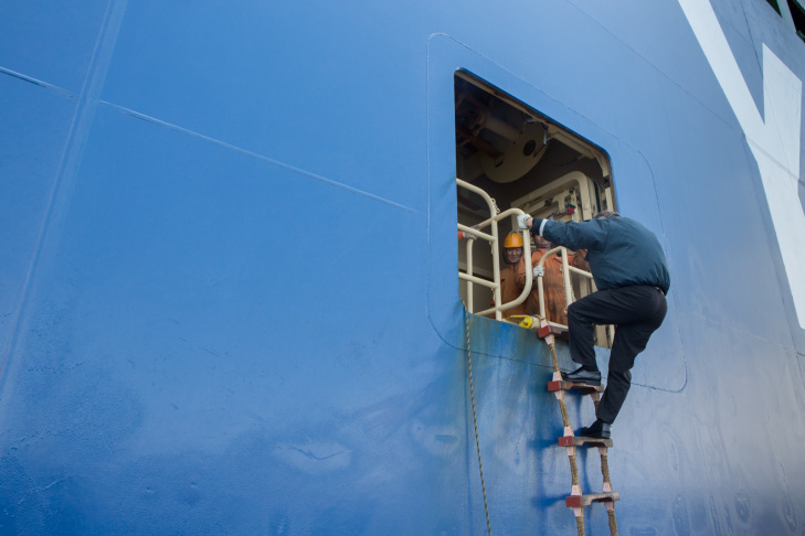 Port Pilot Brett McDaniels prepares to get onto a large cargo vessel at The Port of Los Angeles