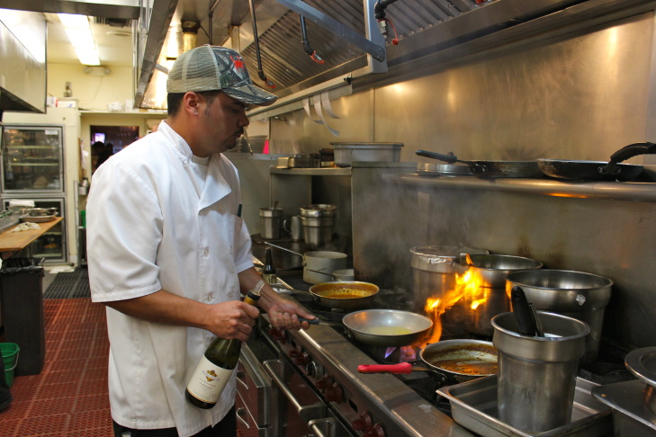 Harold and Belle's CEO Ryan Legaux in the kitchen. He is the third generation Legaux to run this Creole restaurant in South Los Angeles.
