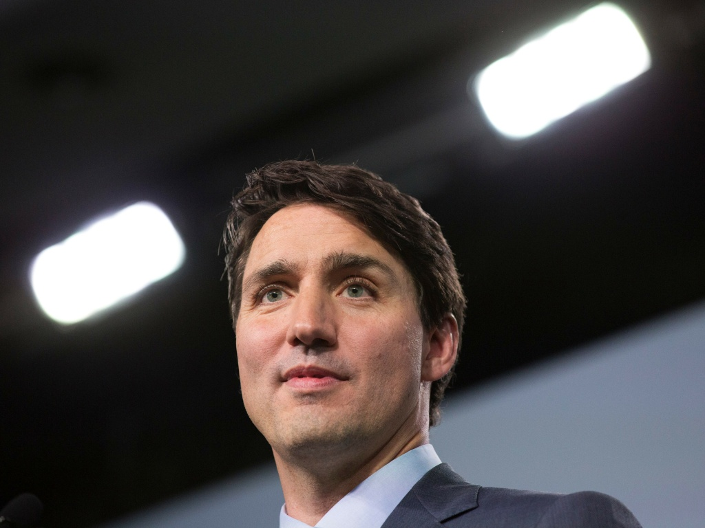 A female reporter in 2000 accused Canadian Prime Minister Justin Trudeau, photographed at a press conference during the G7 summit in June, of groping her.