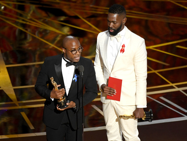 Barry Jenkins, foreground left, and the cast accept the award for best picture for