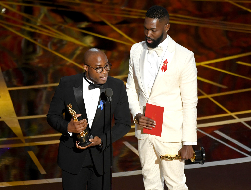 Writer/director Barry Jenkins (L) and writer Tarell Alvin McCraney accept Best Adapted Screenplay for