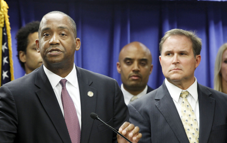 U.S. Attorney Andre Birotte, left, and FBI Assistant Director in Charge Bill Lewis speak at news conference Friday, Feb. 21, 2014, in Los Angeles. Federal law enforcement authorities on Friday announced multiple charges of bribery and cover-ups against state Sen. Ron Calderon, a Democratic state lawmaker and his brother, the result of a long-running corruption investigation that has tarnished the state's majority party.