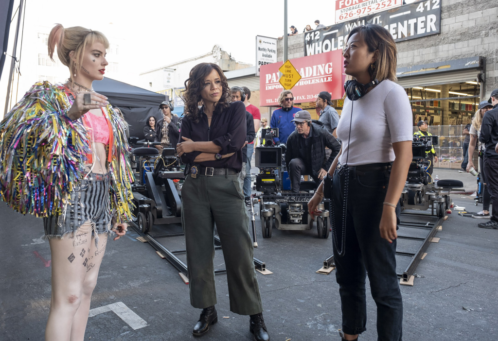 Director Cathy Yan (R) on the set of