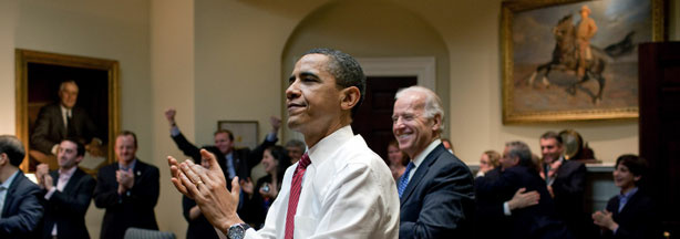 President Barack Obama, Vice President Joe Biden and senior staff applaud in the Roosevelt Room of the White House as the U.S. House of Representatives passed the health care reform legislation Sunday, March 21.