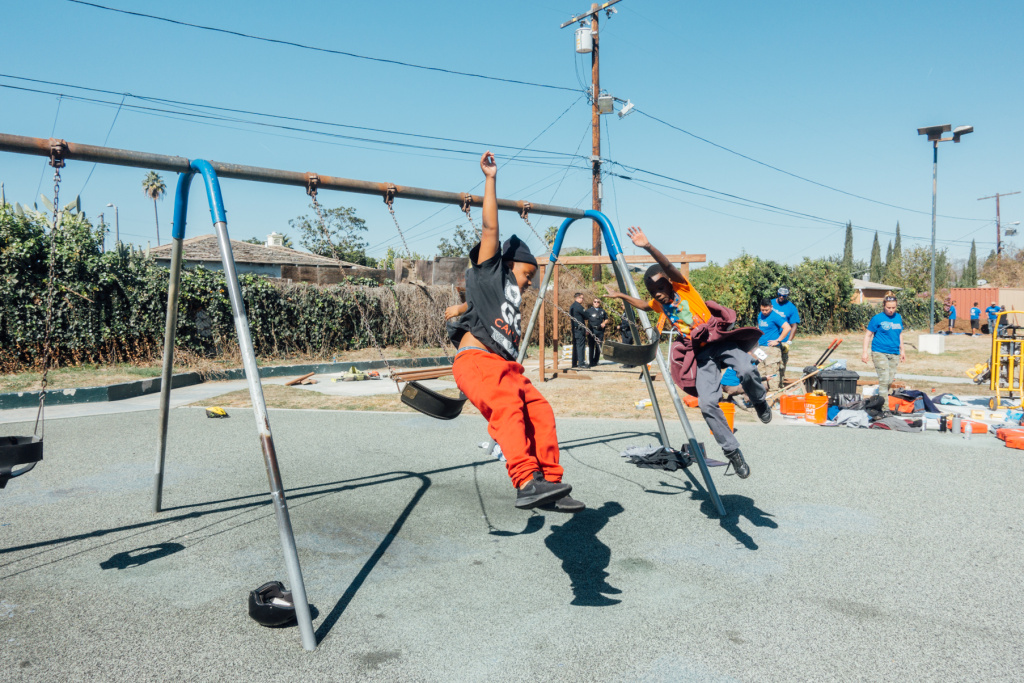 Fun on the swing set at Gonzaque Village in Watts during the Mission Continues service platoon event on Saturday, February 24th, 2018.