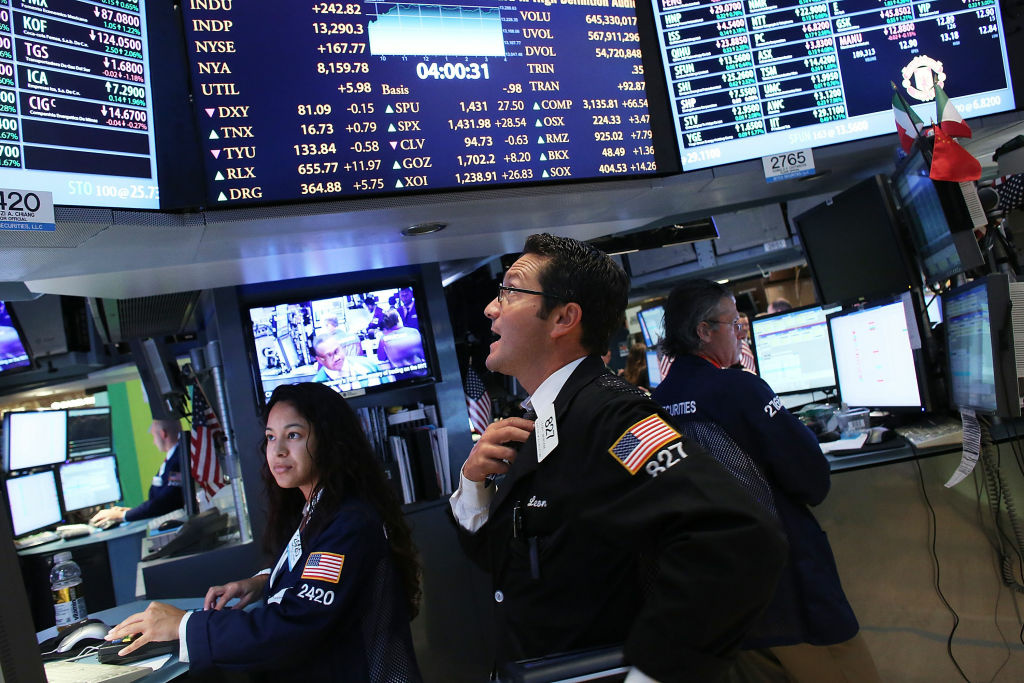 Traders work on the floor of the New York Stock Exchange on September 6, 2012 in New York City.