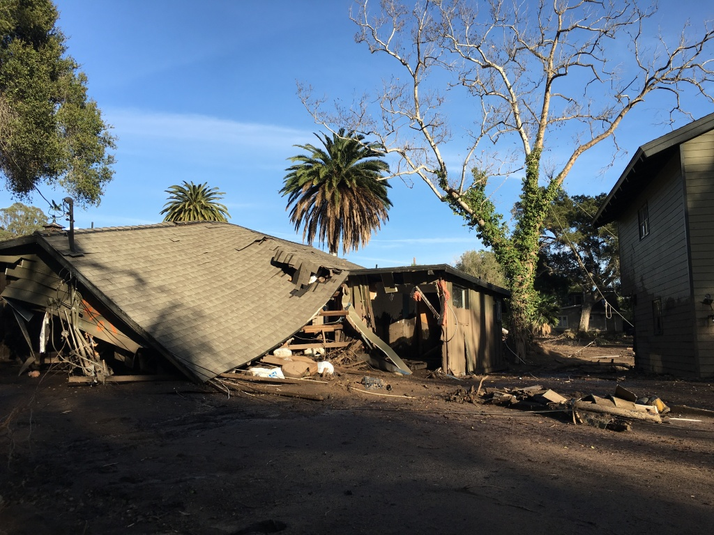 This file photo shows one of the homes that was flooded along East Valley Road when Montecito Creek overflowed its banks during a mud and debris flow Jan. 8, 2018. Santa Barbara County officials say residents of certain areas on the western edge of Montecito will be allowed to return at midday Tuesday after weeks of being evacuated.
