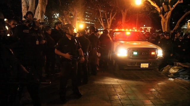Members of the Los Angeles Police Department patrol the park in front of City Hall in downtown in the early hours of November 30, 2011 in Los Angeles, California. Protesters remained on the City Hall lawn despite a deadline, set by Los Angeles Mayor Antonio Villaraigosa, to dismantle their campsite and leave the park which the city declared closed as of 12:01 am November 28th.