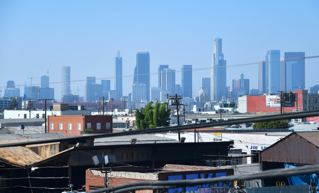 The downtown skyline of Los Angeles, California on October 12, 2017 where a new report from USC and Beacon Economics shows Southern California's housing crisis is leading to an increase in rent for Los Angeles and Orange county into 2019.