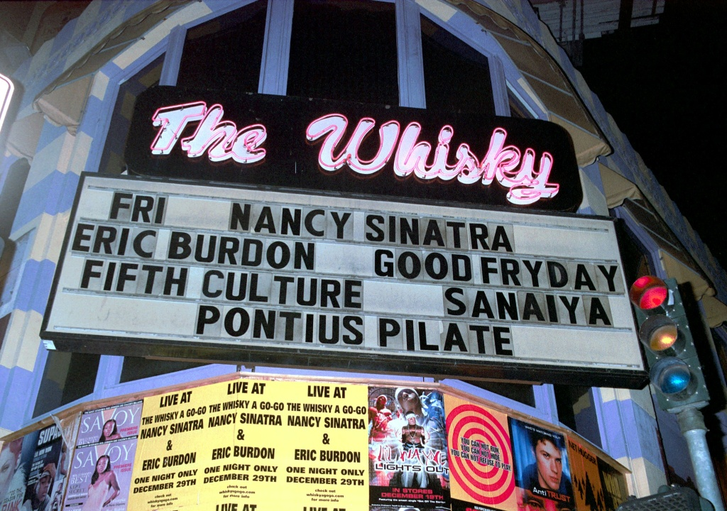 File: A sign lights up the street outside The Whisky A Go-Go where singer Eric Burdon of The Animals and singer Nancy Sinatra performed December 29, 2000 in Hollywood.