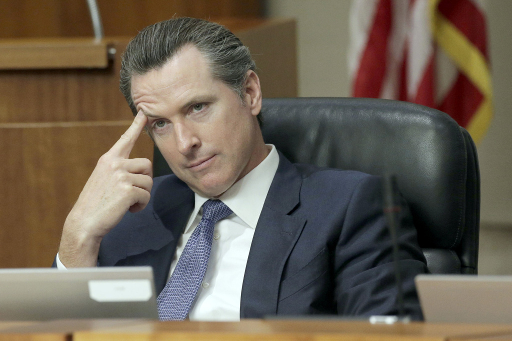 FILE - In this Nov. 17, 2015 file photo, California Lt. Gov. Gavin Newsom listens during a California State University trustees meeting in Long Beach, Calif. The University of California's governing board is considering a policy that would nearly triple the number of student-athletes who would be guaranteed financial aid to continue their studies in the event of a career-ending sports injury. The proposal scheduled to be voted on Wednesday, May 11, 2016, came from a working group of UC athletic directors tasked with making recommendations for improving the well-being of students who participate in intercollegiate sports. Newsom's office participated in the discussions.  (AP Photo/Nick Ut, File)