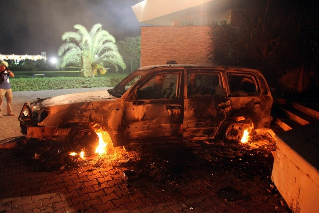 A vehicle sits smoldering in flames after being set on fire inside the U.S. consulate compound in Benghazi late on Sept. 11, 2012. An armed mob protesting over a film they said offended Islam, attacked the U.S. consulate in Benghazi and set fire to the building, killing one American, witnesses and officials said.