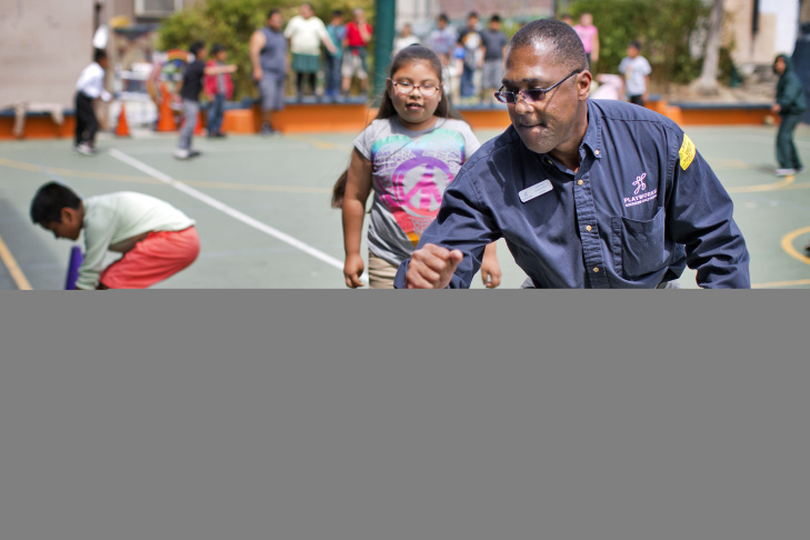 LaVal Brewer, executive director of Playworks Southern California, plays handball with second graders at Camino Nuevo Charter Academy's Burlington campus in Los Angeles.
