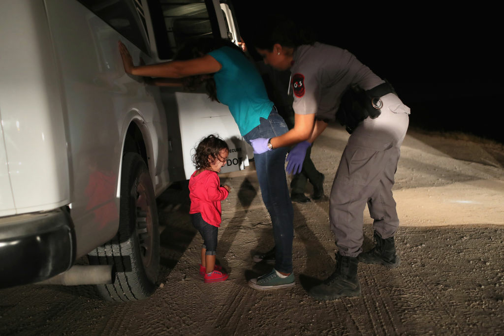 MCALLEN, TX - JUNE 12:  A two-year-old Honduran asylum seeker cries as her mother is searched and detained near the U.S.-Mexico border on June 12, 2018 in McAllen, Texas. The asylum seekers had rafted across the Rio Grande from Mexico and were detained by U.S. Border Patrol agents before being sent to a processing center for possible separation. Customs and Border Protection (CBP) is executing the Trump administration's zero tolerance policy towards undocumented immigrants. U.S. Attorney General Jeff Sessions also said that domestic and gang violence in immigrants' country of origin would no longer qualify them for political asylum status..  (Photo by John Moore/Getty Images)