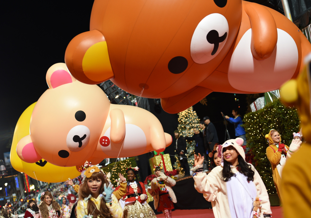 Parade participants wave to the crowd at the 85th annual Hollywood Christmas Parade on Hollywood Boulevard in Hollywood, on November 27, 2016.