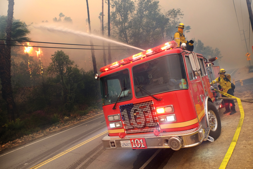 Firefighters from various departments work to protect structures as the Woolsey Fire moves through the property on Cornell Road near Paramount Ranch on November 9, 2018 in Agoura Hills, California.