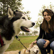 KPCC producer Mary Plummer tries out urban mushing. Here she is with siberian huskies Obi (left) and Leica (right).