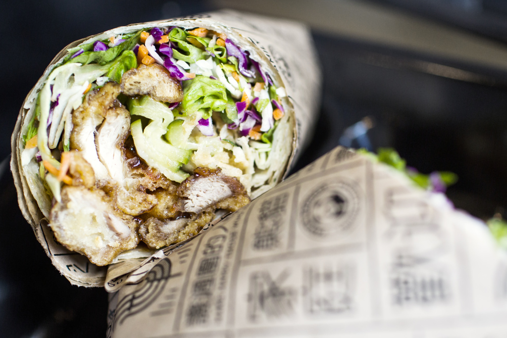 An orange chicken scallion pancake wrap is one of several newly developed dishes at the Panda Express Innovation Kitchen in Pasadena. It has pickled cucumbers, crispy wontons and salad greens.